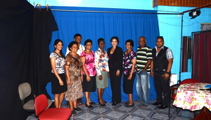 Chief Executive Officer, Dr. Prudence Lewis- Bhola ( fourth from right), Administrative Manager, Mrs. Violet Boyal (fifth from right), Public Relations Officer Ag. ( first from right) & Management of DTV Channel 08